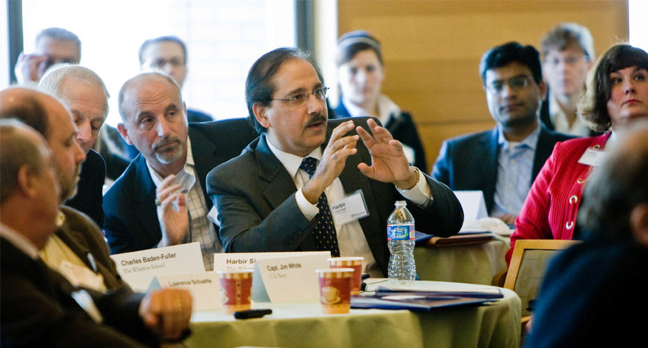 Mack Institute Co-director Harbir Singh (center).